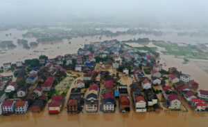 Crop-fields and residential buildings are submerged in floodwater caused by a heavy rainstorm in Zhuzhou, China