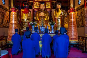Taoist monks praying at The City God Temple (Chenghuang Miao Temple) in Shanghai (Image: Alamy)