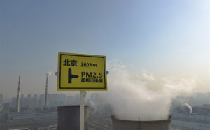pm 2.5 warning sign near coal plant