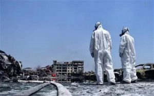 two workers who are part of specialist chemicals unit at the scene of last week's explosions in Tianjin, where the release of highly-toxic sodium cyanide is the main concern (Image by weibo)