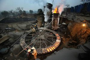 A small scale steelworks in China powered by burning coal.