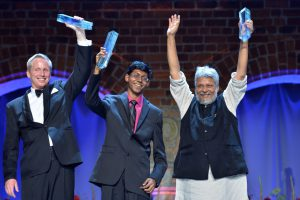 Perry Alagappan, pictured centre, scooped an award for a US$20 water filter that removes poisonous compounds from electronic waste. (Image byJonas Berg / World Water Week)
