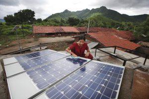 woman assembles solar panel