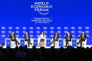 business leaders on stage at the world economic forum in Davos