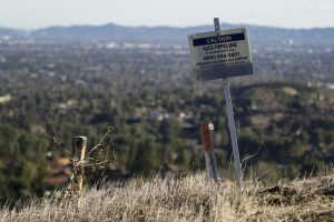 California's unhappy valley. signpost with the words 'Caution: gas pipeline'.A huge leak of methane over the past few months from a natural gas storage site is equivalent to a quarter of the state's GHG emissions