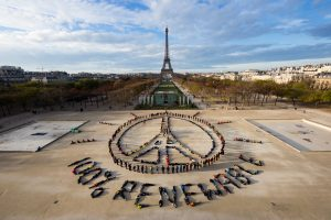 100% renewable sign in front of the Eiffel Tower, champs de mars