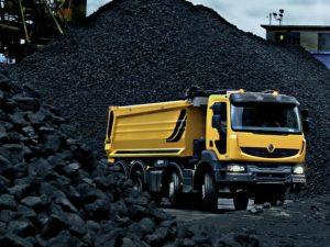 truck moving through coal plant