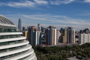 A view of Galaxy Soho, Beijing against a blue sky.