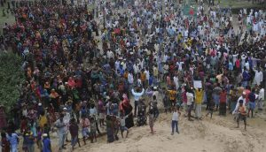 Residents of Gondamara in coastal Bangladesh gather to protest the building of a coal-fired power plant in their village (Image by Minhaz)