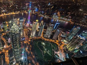 a sprawling night time view of Shanghai