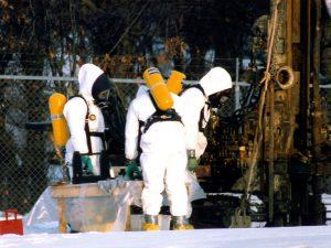 Workers in 'Hazmat' suits at aUS Superfund site.
