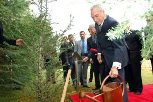 New interim Brazilian president Michel Temer watering trees. Under his watch, Brazil's congress is expected to approve a law weakenening environmental protection (Image by