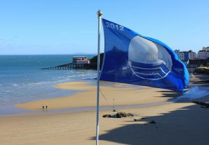 A beach in Tenby, western Wales, displays an EU-awarded Blue Flag denoting water quality