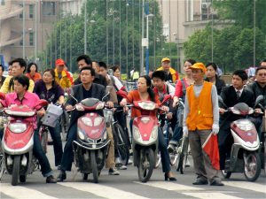 Electric bikes waiting for the traffic signal in Chengdu, Sichuan. (Image by