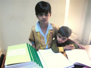 Rabab Ali, with her younger brother (Image courtesy Qazi Ali Athar)