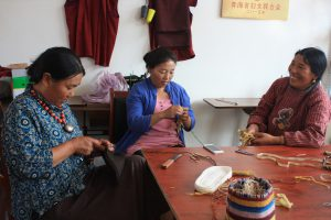 Women from Maozhuang making yak felt slippers. Cooperatives can help communities develop sustainably and provide a source of funds for environmental protection (Image by Wang Yan)