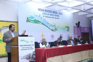 Shashi Shekhar, India's top water official, standing on a podium speaking about India's water problems