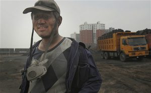 Worker at the Mengfa Energy Group coal cleaning plant, Ordos, Inner Mongolia.(Image by Qiu Bo / Greenpeace)