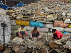 Women sort through waste plastics on the outskirts of Guangzhou