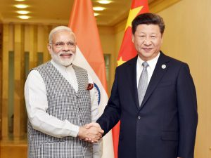 China and India president. Narendra Modi and Xi Jinping shake hands
