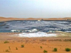 Waste water pits hidden among the dunes in Tengger Desert(Image: Chen Jie / New Beijing)