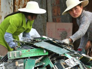 Chinese woman dismantling electronic computer