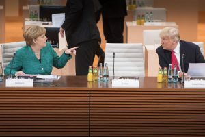 Merkel in conversation with Trump in Hamburg. (Image: German Government/Bergmann)