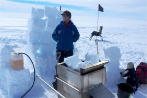 The author prepares to assist his colleague, Bryn Hubbard from Aberystwyth University, in drilling a borehole in Larsen C using pressurised hot water. (Image: MIDAS, Author provided)