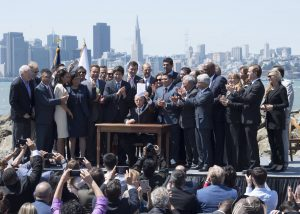 Governor Jerry Brown signs an extension of California's cap and trade scheme, setting an example for other leaders with ambitious climate goals. (Image: California State Senate)