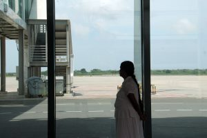 A local tourist looks out onto an empty runway at Sri Lanka's Mattala Rajapaksa International Airport near Hambantota (Image: Chathuri Dissanayake)