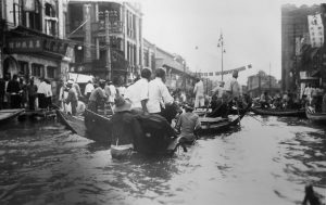 Rickshaw pullers working the flooded streets