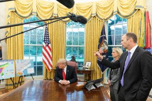President Trumplistens as FEMAadministrator Brock Long addresses reporters on Oct10 on the possible impact of Hurricane Michael on the south-east US. (Image:Shealah Craighead)