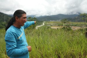 Luis Sánchez Shiminaycela points to the construction works near the house he was evicted from (Image: Andrés Bermúdez Liévano)