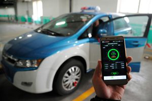 An electric taxi in Taiyuan, Shanxi province, in need of a charge (Image: Alamy)