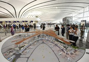 A model of Beijing's airport, Daxing's terminal building within the terminal itself, on the day the airport opened, 25 September 2019 (Image: Alamy)