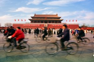 China and the environment: citizens cycle beneath blue skies over Beijing (Image: Alamy)