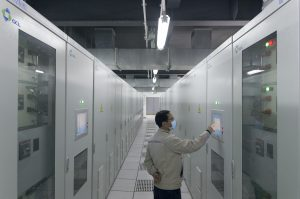 A Golden Concord employee walks through the company's energy storage plant in Suzhou, April 3, 2020. (Image: Kevin Schoenmakers)