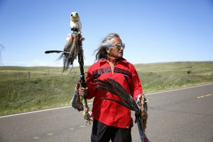 Waki Little Thunder of the Rosebud Sioux Tribe poses for a portrait after a protest march to the proposed route of the Dakota Access Pipeline in North Dakota on August 26, 2016. If built according to plan, the pipeline will run underneath the Missouri River near here. Members of the Standing Rock Sioux Tribe, and many tribes, worry that if the pipeline leaks it will pollute the river. (Photo by Terray Sylvester)