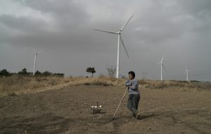 Up on the hill you can hear the new turbines spinning in the strong breeze. Chen Fang, from the village of Taizigou, hopes the wind will bring rain so she can plant her seeds.​