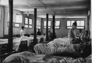 black and white photograph of patients in a ward in Lanzhou, China, 1945