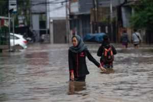Heavy flooding in Jakarta in February this year. Infastructure projects have been implicated in making these events worse. (Image: Alamy)