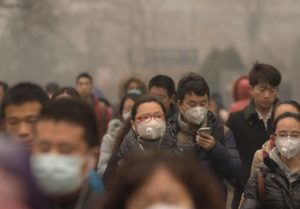 People wearing face masks on their way to work in Beijing, China.