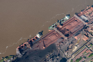 aerial image of cargo vessels loading on the Parana River at Muelle Carbon Siderar in the port of Barrio 7 de Septiembre, San Nicolas de los Arroyos,