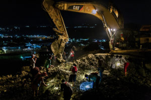 Informal miners search for jade in a slag heap near the town of Hpakant in northern Myanmar (Image © Hkun Lat)