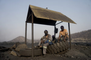 "Miners take a break at a Makomo Resources coal mine in Hwange. Makomo and Zambezi Gas are some of the newer players in Hwange's coal-mining scene. (Image: <a href=""https://www.kbmpofu.com/"">KB Mpofu</a> / China Dialogue)"