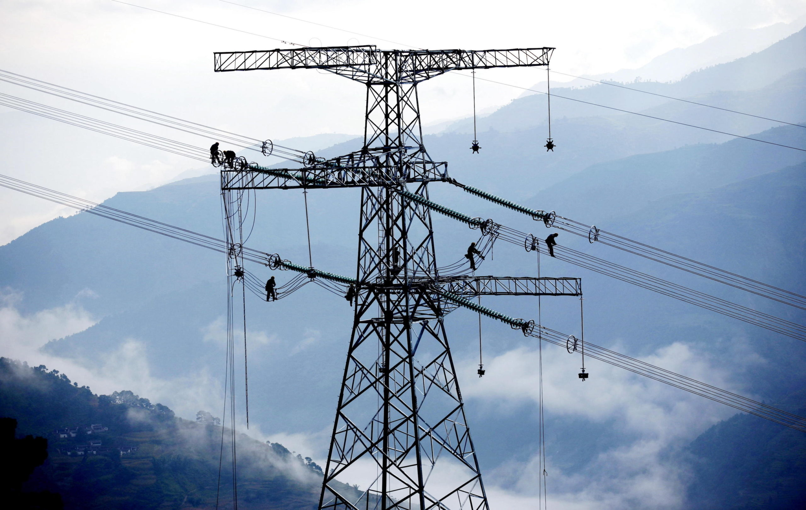 Electricians install power lines near the Xiaowan hydropower station in southwest China's Yunnan province, where coal has played a supporting role in the power mix for years (Image: Alamy)