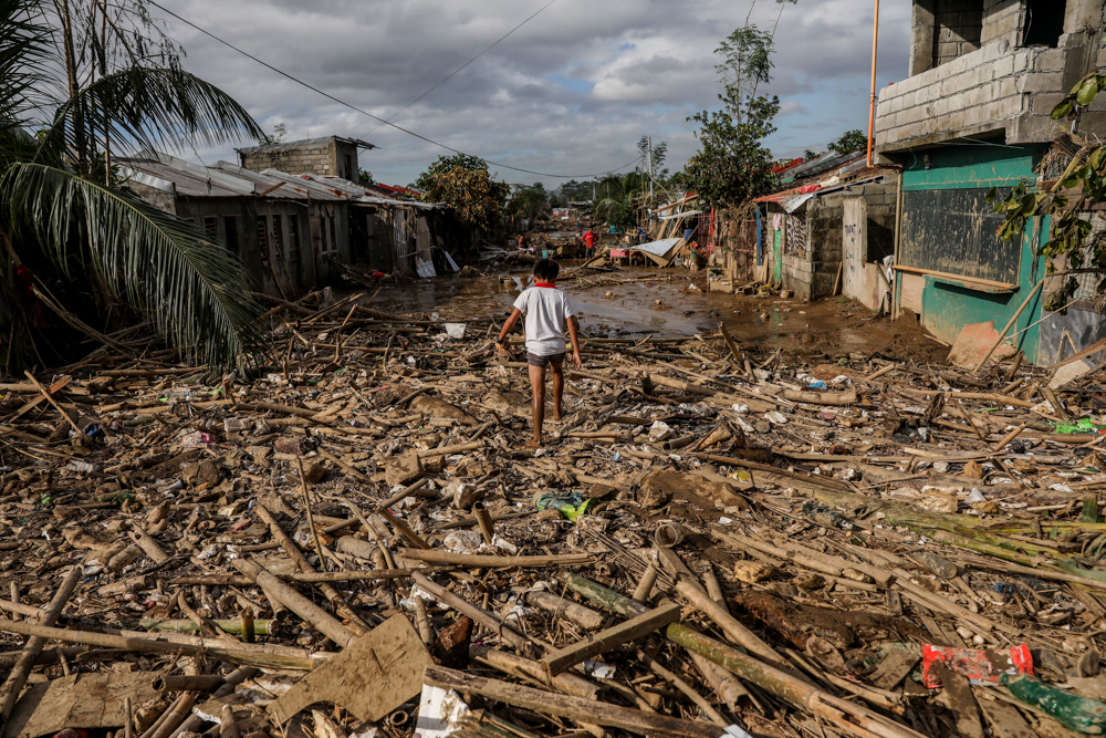 Typhoon Vamco left devastation in its wake when it hit the Philippines in November last year.  The increasing intensity and frequency of storms like Vamco is just one of the impacts of climate change already affecting people around the world. (Image © Basilio H. Sepe / Greenpeace)