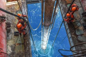 Chinese workers drill for oil in the South China Sea