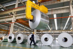 Coiled aluminium sheets at a production plant in Anhui, east China. Aluminium is an essential raw material for emerging sectors such as electric vehicle manufacturing and renewable power (Image: Alamy)
