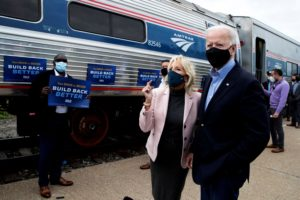 President Joe Biden and his wife Jill greet supporters as they prepare to board an Amtrak train